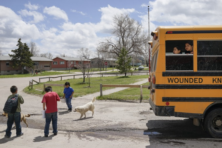 Students leave class and wait for the bus on the last day of classes at the Wounded Knee District School in Manderson, South Dakota.