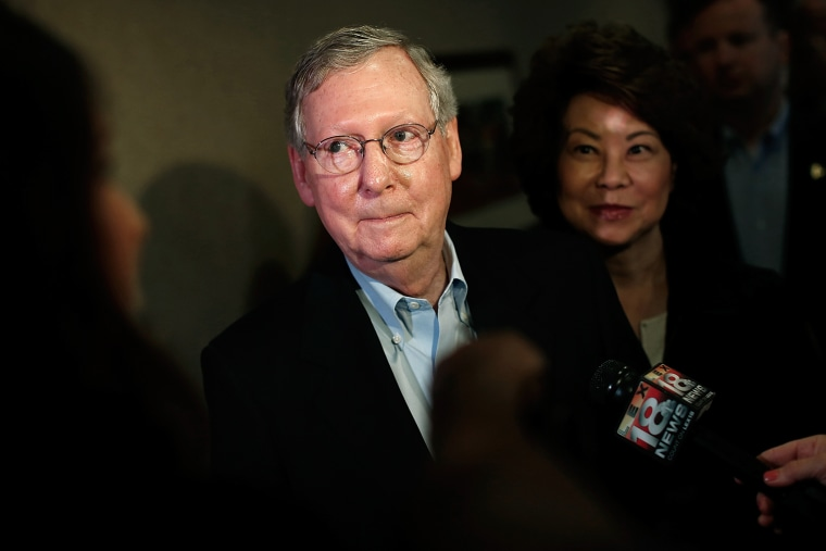 Senate Republican Leader Sen. Mitch McConnell (R-KY) answers questions  while speaking to the press at at a campaign rally with his wife Elaine Chao (R) May 19, 2014 in Louisville, Ky.