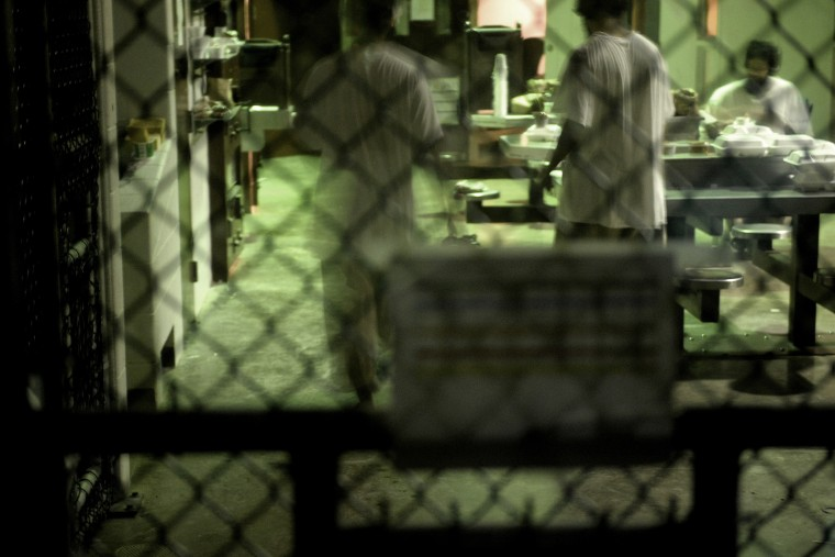 """This photo made during an escorted visit and reviewed by the US military shows unidentified detainees at \""""Camp 6\"""" detention facility at the US Naval Station in Guantanamo Bay, Cuba, April 8, 2014."""