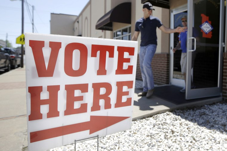 Trey Petrus of Carlisle, Ark., leaves an early voting polling place in Lonoke, Ark., May 5, 2014.