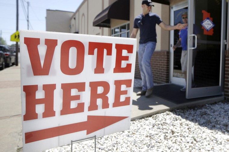 Trey Petrus of Carlisle, Ark., leaves an early voting poling place in Lonoke, Ark., May 5, 2014.