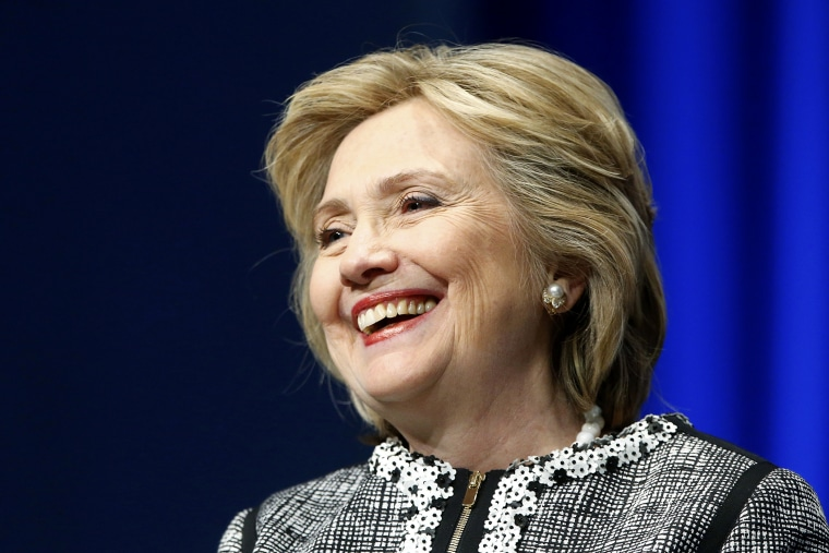 Former U.S. Clinton smiles during a lengthy ovation for her at the start of an event on empowering woman and girls, at the World Bank in Washington