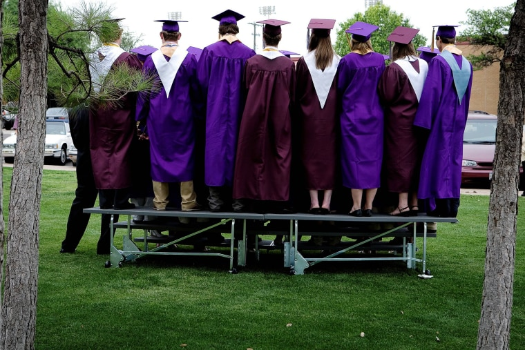 High school students at graduation.