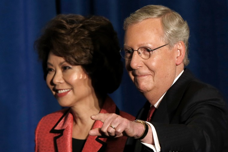Senate Republican leader Sen. Mitch McConnell (R-KY) and his wife Elaine Chao arrive for a victory celebration following the early results of the state Republican primary May 20, 2014 in Louisville, Ky.