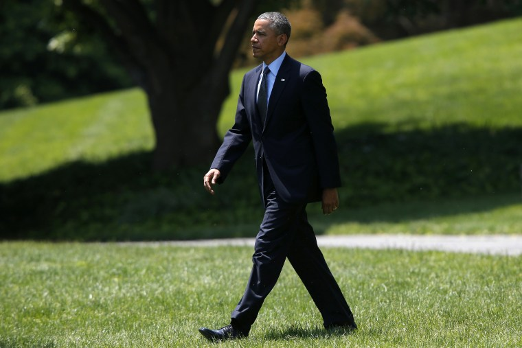 President Barack Obama walks on the South Lawn of the White House in Washington, D.C., May 22, 2014.