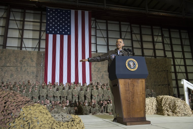 President Barack Obama speaks during a surprise visit with US troops at Bagram Air Field, north of Kabul, in Afghanistan, May 25, 2014, prior to the Memorial Day holiday.