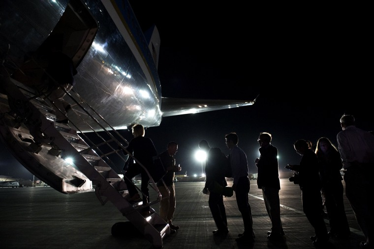 Members of the press and staff board Air Force One at Bagram Air Field, north of Kabul, in Afghanistan, May 26, 2014.