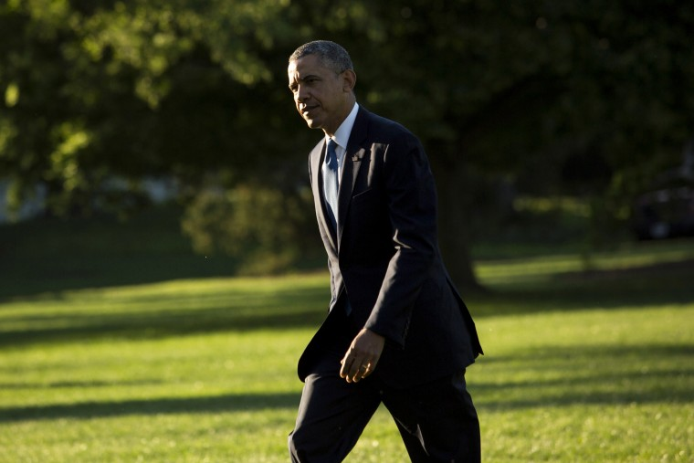 President Barack Obama walks across the South Lawn after returning to the White House, May 26, 2014.