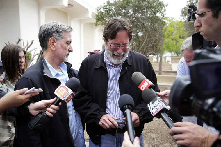 Richard Martinez is comforted by his brother, Alan, as he talks to media outside the Santa Barbara County Sheriff's Headquarters, May 24, 2014.