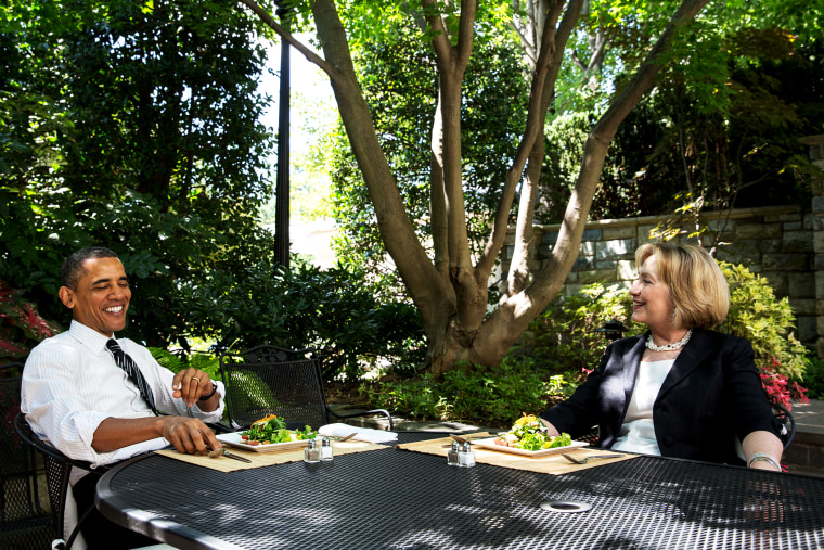 U.S. President Barack Obama has lunch Hillary Rodham Clinton on the patio outside the Oval Office, July 29, 2013.