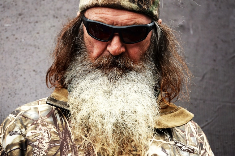 Phil Robertson takes part in pre-race ceremonies for the NASCAR Sprint Cup Series Duck Commander 500 at Texas Motor Speedway on April 6, 2014.