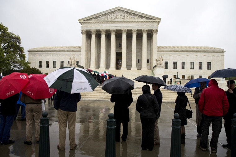 People line up outside the Supreme Court to listen to arguments, April 29, 2014, in Washington.