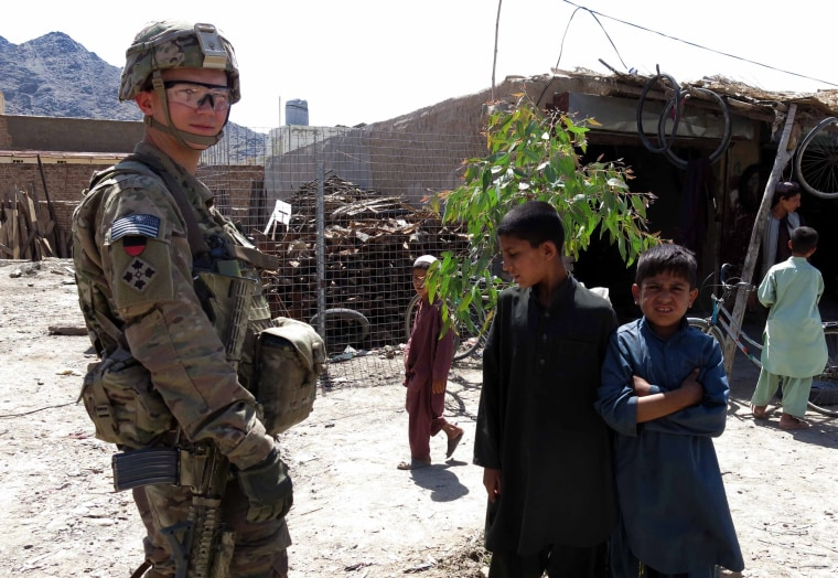 A U.S. NATO soldier visits a market of Kandahar, Afghanistan, May 27, 2014.