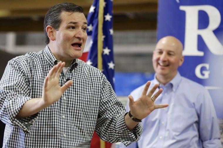 Sen. Ted Cruz, R-Texas, left, campaigns in Omaha, Neb., Friday, May 9, 2014, on behalf of Nebraska Republican gubernatorial candidate Pete Ricketts, right.