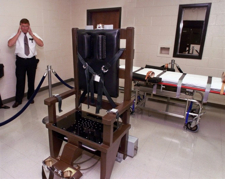 Ricky Bell, the warden at Riverbend Maximum Security Institution in Nashville, Tenn., gives a tour of the prison's execution chamber Wednesday, Oct. 13, 1999.