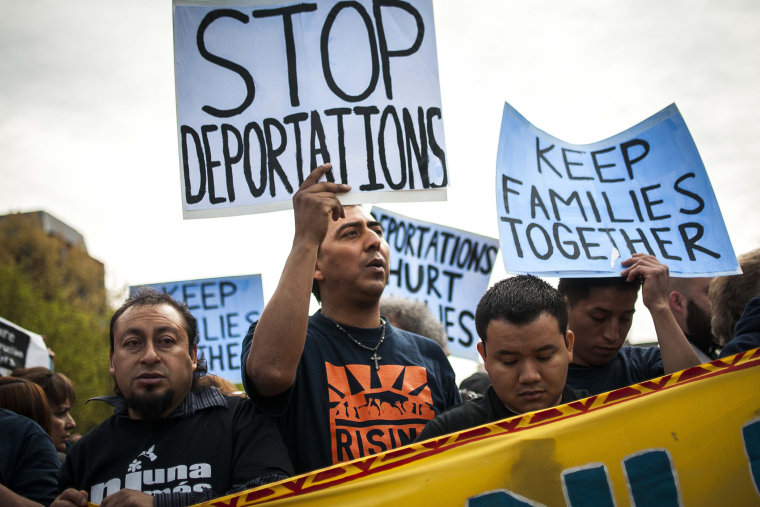Demonstrators protest for immigration reform in front of the White House, April 28, 2014.