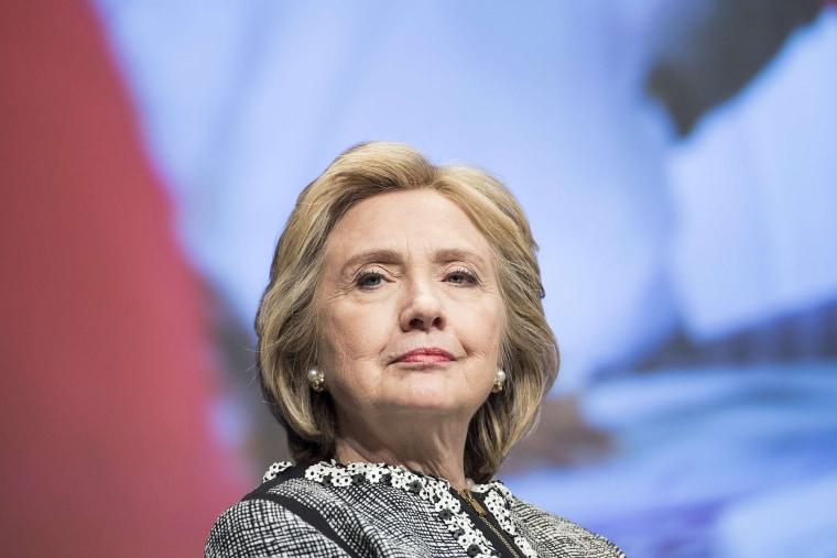 Hillary Clinton waits to speak at the World Bank in Washington, DC, May 14, 2014.