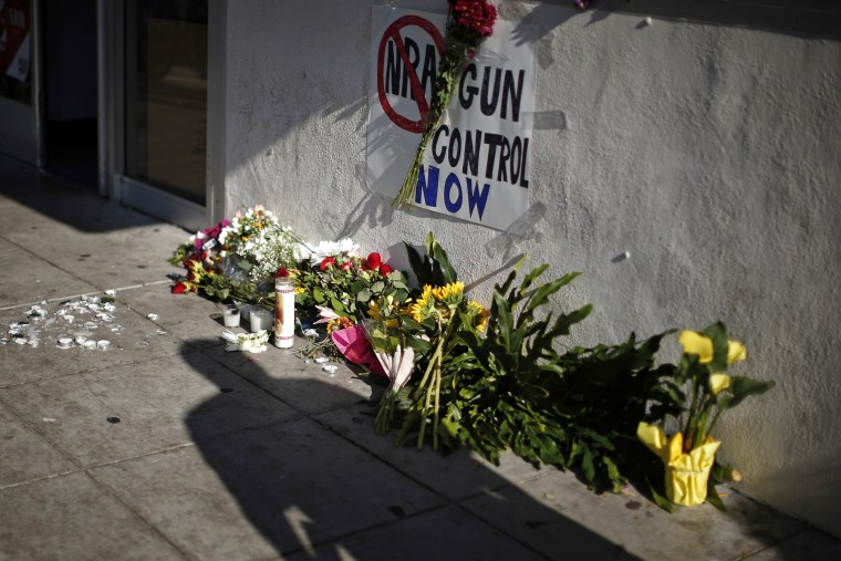 A sign advocating gun control is seen on a makeshift memorial for UCSB student Christopher Michael-Martinez in Isla Vista