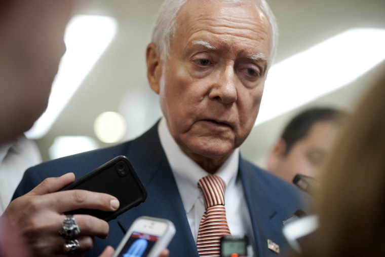 Sen. Orrin Hatch, R-UT., talks to reporters as he walks to the weekly Senate policy luncheons in the U.S. Capitol on June 4, 2013.