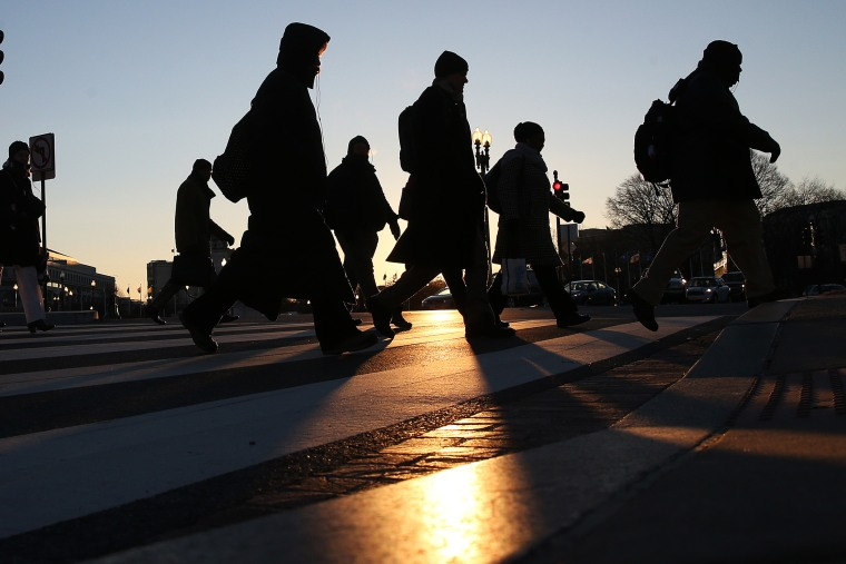 Commuters brave the frigid temperature as they cross the street on Capitol Hill, Jan. 7, 2014 in Washington, D.C.