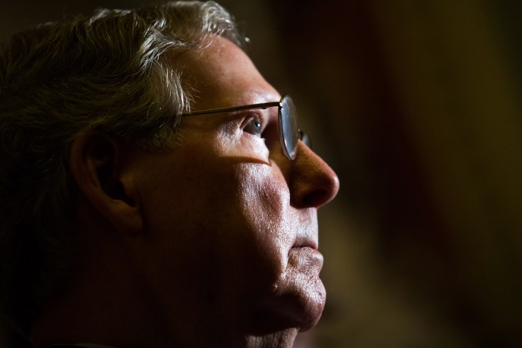 Senate Minority Leader Mitch McConnell (R-Ky.) looks on during a news conference on Capitol Hill, Nov. 21, 2013 in Washington, D.C.