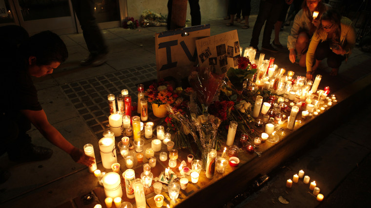 People leave candles and flowers at a growing memorial in front of the IV Deli Mart on Pardall Road in Isla Vista on May 24, 2014 in Santa Barbara, California.