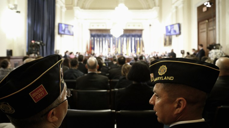 U.S. military veterans listen in the audience during a House Veterans' Affairs Committee hearing on the Phoenix VA Health Care System wait list, on Capitol Hill in Washington