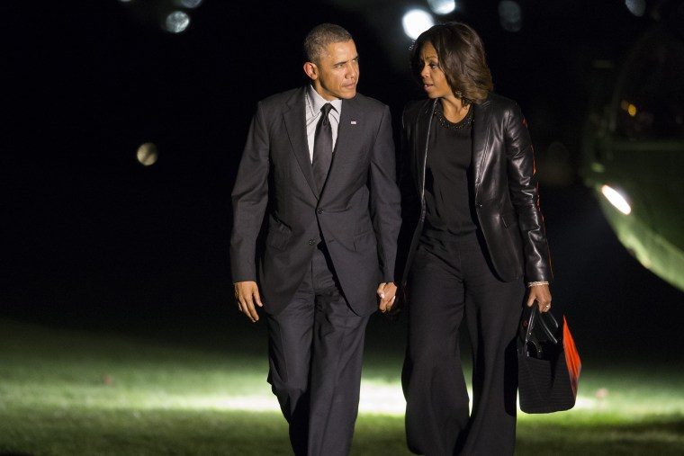 President Barack Obama and first lady Michelle Obama walk to the White House after arriving on the South Lawn, April 12, 2014, in Washington, D.C.