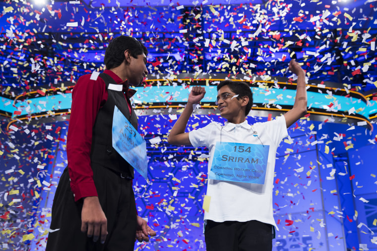 Ansun Sujoe, 13, of Fort Worth, Texas, left, and Sriram Hathwar, 14, of Painted Post, N.Y., celebrate after being named co-champions of the National Spelling Bee, May 29, 2014, in Oxon Hill, Md.