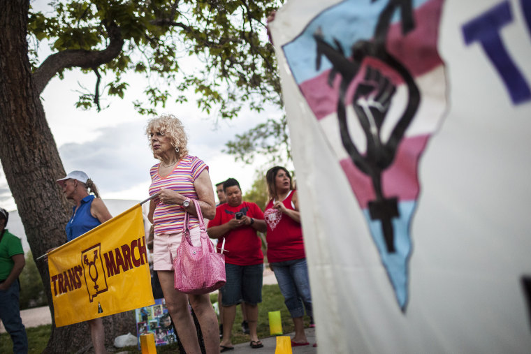 In this May 29, 2014 photo, Denee Mallon, second from left, takes part in the Trans March to Morningside Park in Albuquerque, N.M.