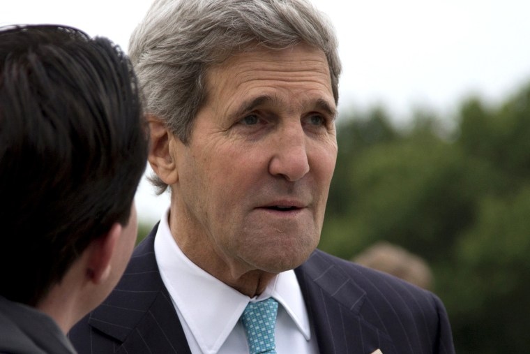 U.S. Secretary of State John Kerry pauses on the tarmac before boarding his plane at Andrews Air Force Base