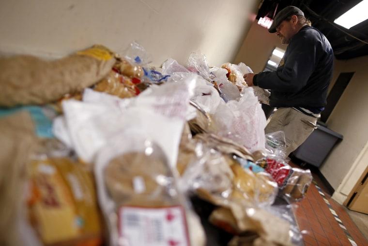 Frank Doyle looks over a table of food at the Emergency Assistance Program at the Chicago Catholic Charities in Chicago