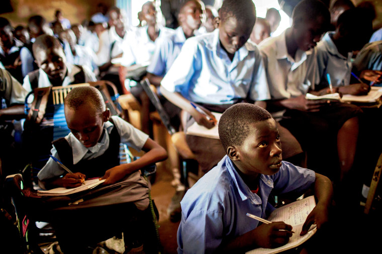 Students take notes during an English language class at the Juba Nabari Primary School, in Juba on April 9, 2014.