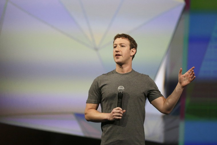 Facebook CEO Mark Zuckerberg gestures while delivering the keynote address at the f8 Facebook Developer Conference, April 30, 2014, in San Francisco, Calif.