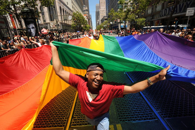 Mark Wilson carries a rainbow flag during San Francisco's 42nd annual gay pride parade, June 24, 2012.