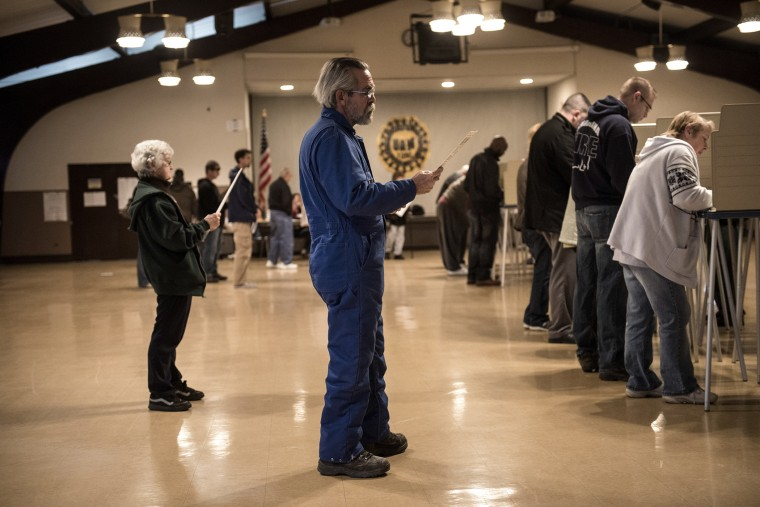 People wait as others vote at the United Auto Workers Local 1250 Hall during election day November 6, 2012 in Cleveland, Ohio.