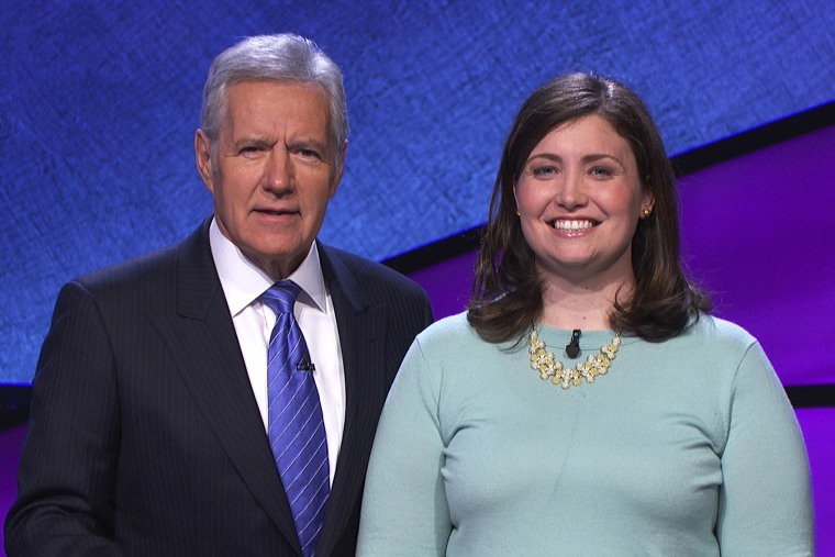 """Alex Trebek poses with """"Jeopardy!"""" contestant Julia Collins, January 2014."""
