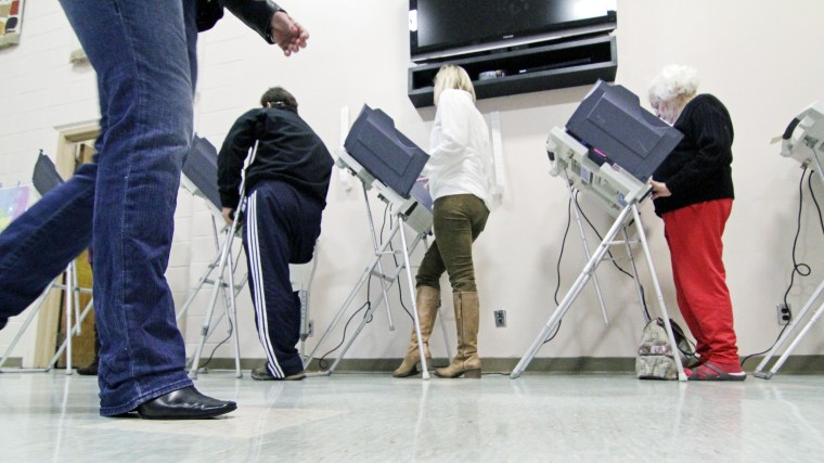 A voter walks to an empty electronic voting booth at a Madison, Miss., precinct, Tuesday, Nov. 6, 2012.