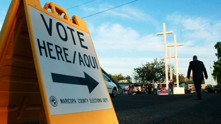 People arrive to vote in Phoenix, Arizona.