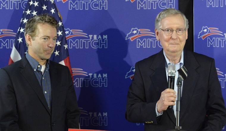 Kentucky Senators Mitch McConnell, left, and Rand Paul address the media during a press conference, May 23, 2014, in Louisville, Ky.