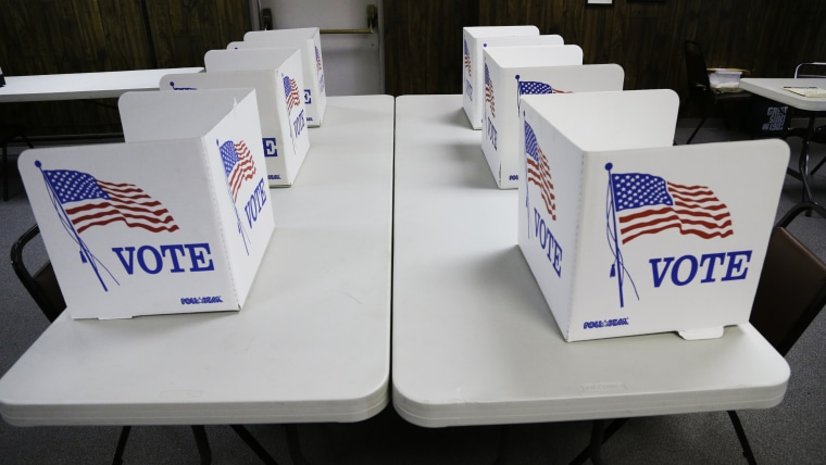 Voting booths await voters in Red Oak, Iowa, Tuesday, June 3, 2014, ahead of the Iowa primary elections.