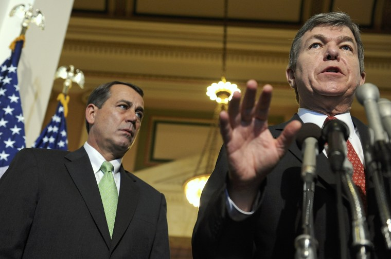 Rep. Roy Blunt (R-MO) and House Minority Leader John Boehner (R-OH) speak to reporters on Capitol Hill in Washington, October 3, 2008.