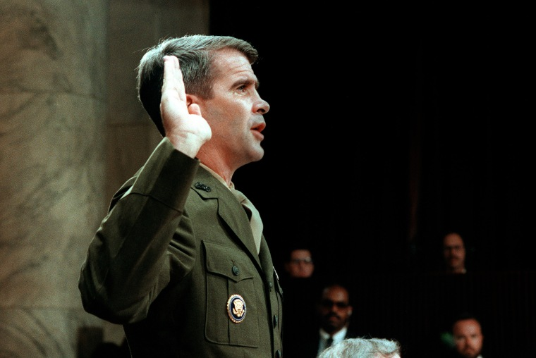 Lieutenant-Colonel Oliver North is sworn in July 7, 1987 before the House and Senate Foreign Affairs Committee hearing in Washington, D.C. on arms sales to Iran and diversion of profits to Nicaraguan Contra rebels.
