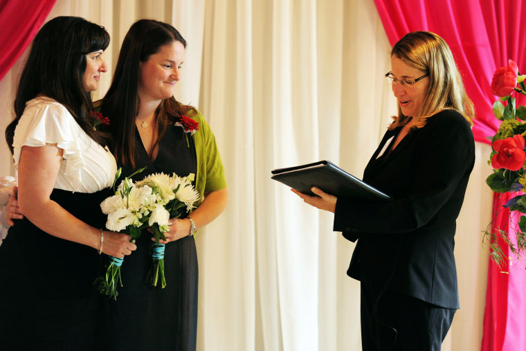 Julia Fraser, left, and Jessica Rohrbacher get married in Portland, Ore., May 19, 2014.