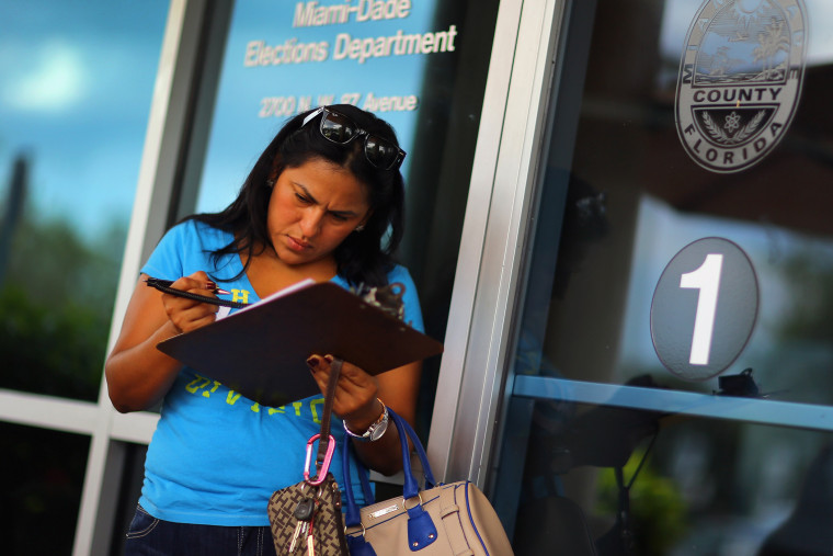 Ereyda Monge fills out her voter registration form at the Miami-Dade Elections Department in Florida.