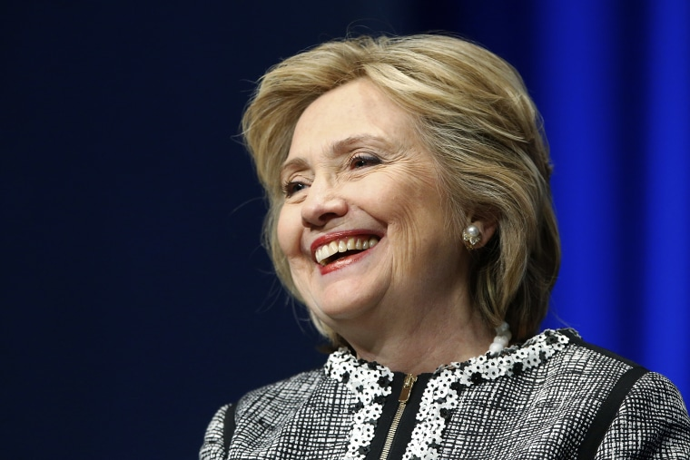 Former U.S. Secretary of State Hillary Clinton smiles during a lengthy ovation for her at the start of an event on empowering woman and girls, at the World Bank in Washington May 14, 2014.