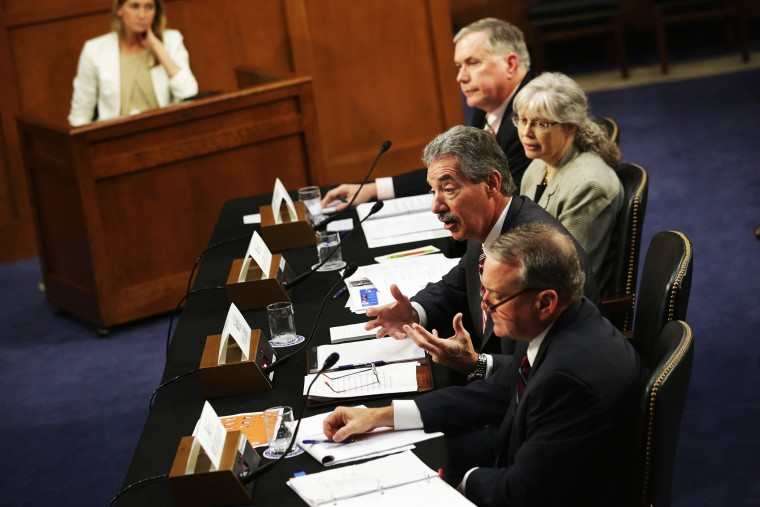 National Security Agency Deputy Director Richard Ledgett, Principal Deputy Director of National Intelligence Stephanie O'Sullivan, Deputy Attorney General James Cole, and FBI Deputy Director Mark Giuliano testify during a hearing before the Senate (Select