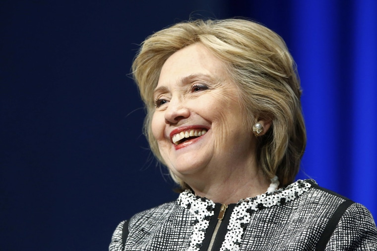 Former U.S. Secretary of State Hillary Clinton smiles at the World Bank in Washington, May 14, 2014.