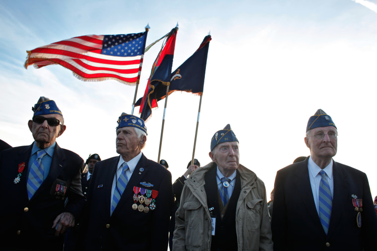 From left, World War II veterans of the U.S. 29th Infantry Division, Hal Baumgarten, 90 from Pennsylvania, Steve Melnikoff, 94, from Maryland, Don McCarthy, 90 from Rhode Island, and Morley Piper, 90, from Massachusetts, attend a D-Day commemoration, on O