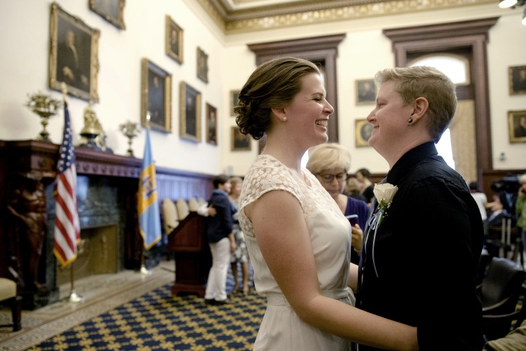 Corey Crawford, right, and Jessica Samph smile to each other before their wedding on May 23, 2014, at City Hall in Philadelphia.